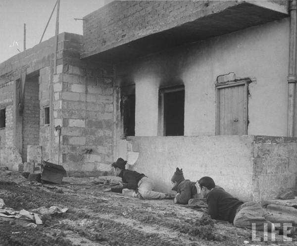 Haganah men crawling along wall. 1948. Tel Aviv, Israel