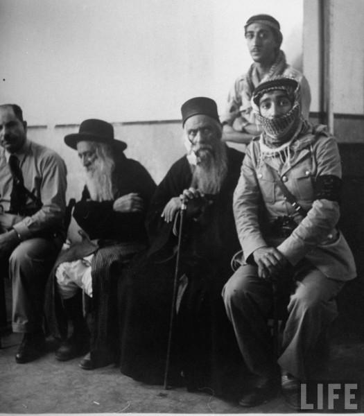 Two Rabbis conference with Jordanin Solgiers. June 1948. John Phillips