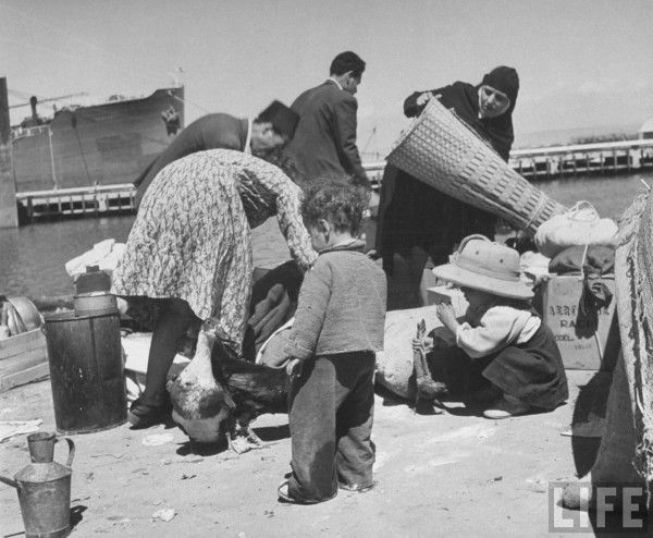 Refugees gathering their belongings to take aboard the British ship, May 1948. John Phillips