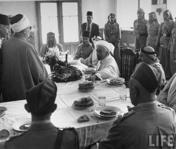 King Abdullah (C) and his party attending a banquet during truce