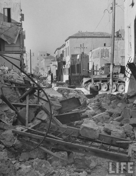 Final patrol by British tanks pushes three rubble strewn streets of Jaffa intent on preventing any further fighting between Jews and Arabs before experation of mandate