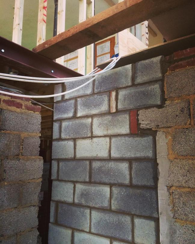 4-inch block wall with a solid concrete pier to hold the underside of the upstairs RSJ steel
