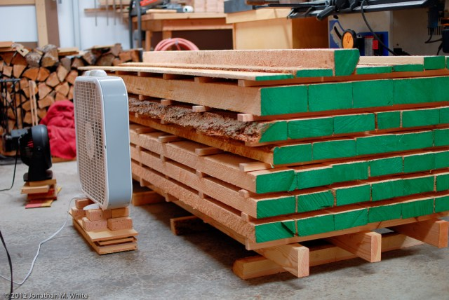 Here is the re-stacked lumber with the ends painted to prevent checking.