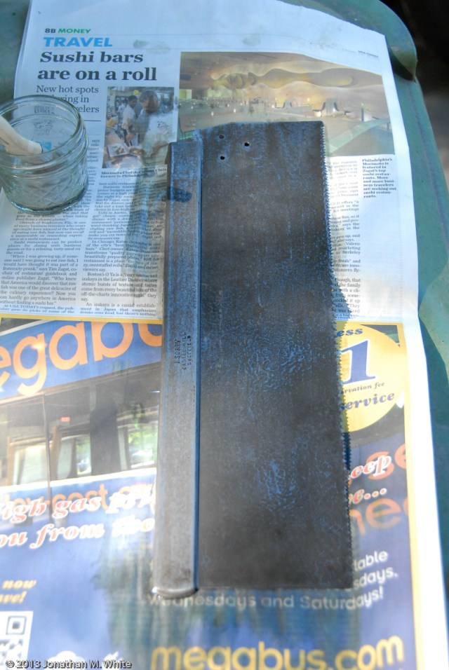 After a few minutes the rust neutralizer starts to blacken the saw plate.