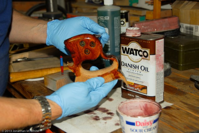 Watco Danish Oil being applied to a saw tote.