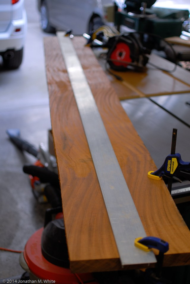 I used 8 foot straight edge and a circular saw to joint one edge of this sapele board.