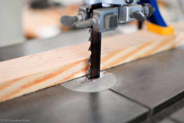 I set up a quick makeshift fence on the band saw to slice off a piece of end-grain sapele.