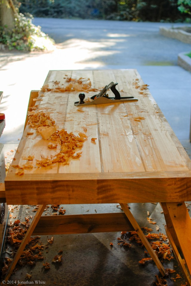I lightly planed the benchtop to level the sapele parts with the douglas fir.