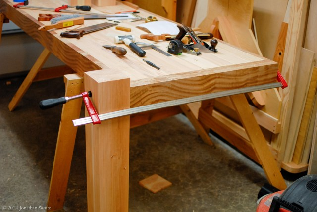 I clamped the leg to the edge of the workbench.
