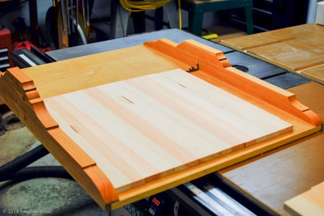 Squaring the panel and cutting to length on the cross-cut sled.