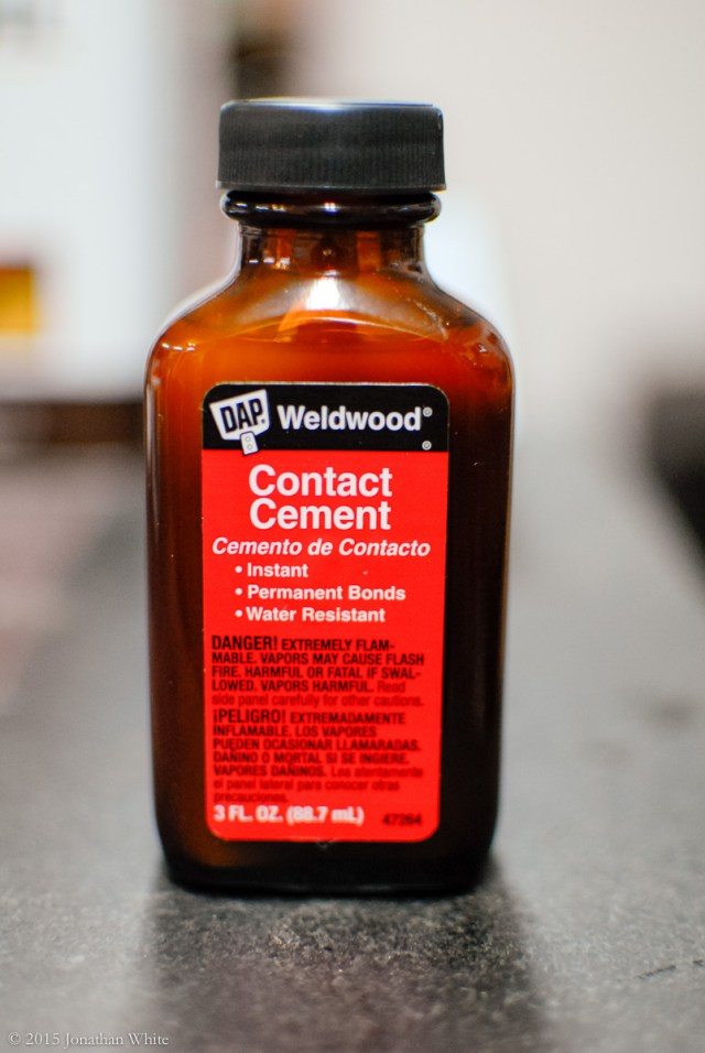 A small bottle of contact cement.