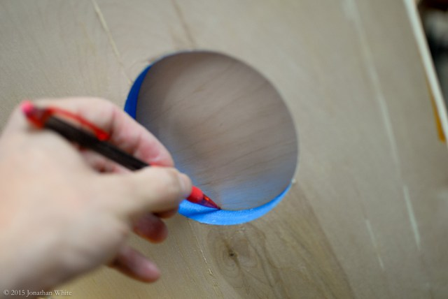 Using a pencil to mark the circle onto the blank.
