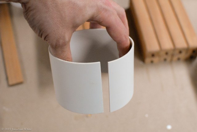 I cut a section out of a piece of PVC pipe.