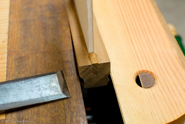 Pairing down the inside face with a chisel.