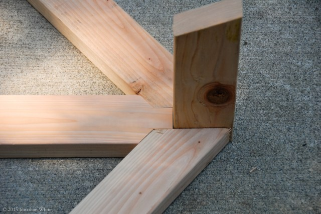 The ridge board will sit directly on top of the king stud.