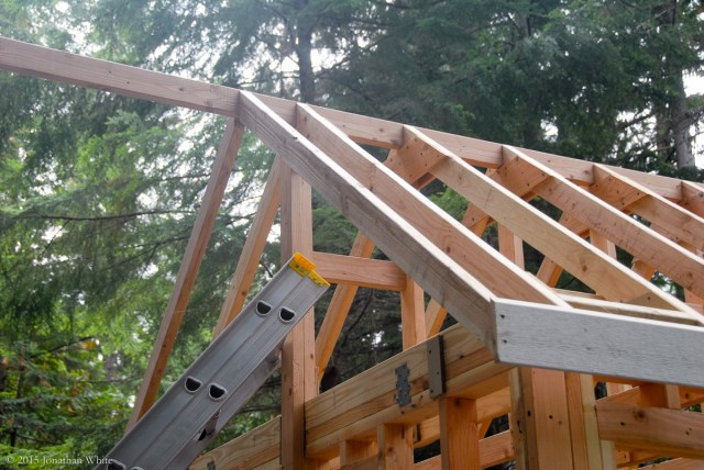A false rafter is attached to the ridge board and fascia board, creating an overhang.