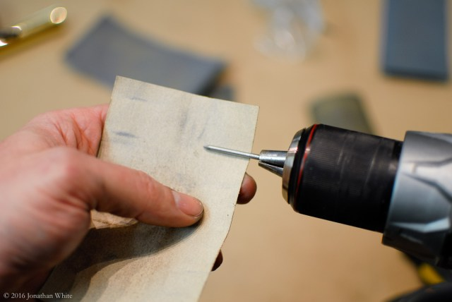 Using 100 grit paper to finalize the thicknessing of the nail.
