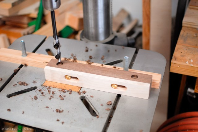 I drilled stopped holes for the bolts that will hold the fence assembly to the board.