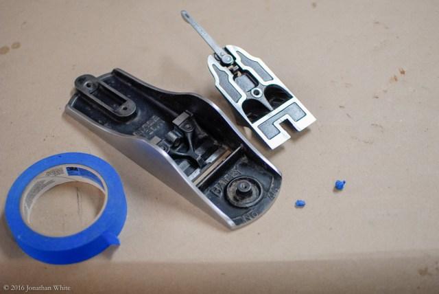 Little balls of masking tape to fill all the threaded bolt holes.