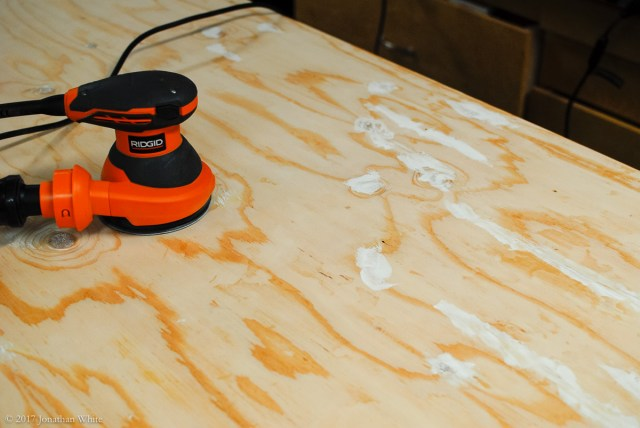 Filling the worst of the defects on the plywood.