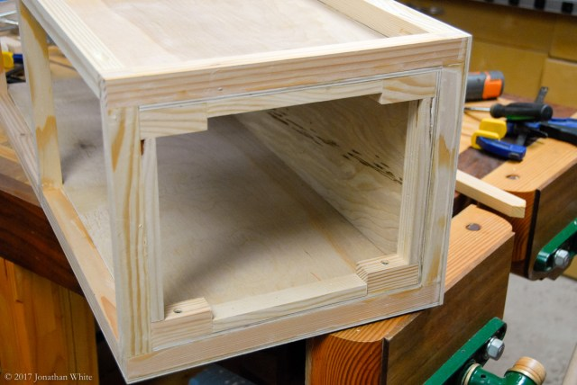 Installing some scrap pieces to support the inside end plywood.