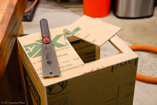 Cutting out the excess plywood from the door opening.
