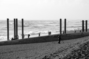 West Pier Busy With People Viewing the Damage
