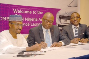 FCMB 2 (4): The Managing Director/Chief Executive of Peugeot Automobile Nigeria (PAN) Limited, Mr. Ibrahim Boyi; the Regional Director, Abuja & North of First City Monument Bank (FCMB) Limited, Mr. Mustapha Lukman and the Head, Retail Assets of the Bank, Mr. Olajire Awofisibe, during the launch of the FCMB/PAN Auto Loan Alliance Scheme on Thursday, October 15, 2015 in Abuja.