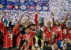 Chilean players celebrate after winning the 2016  Copa America football championship final against Argentina.