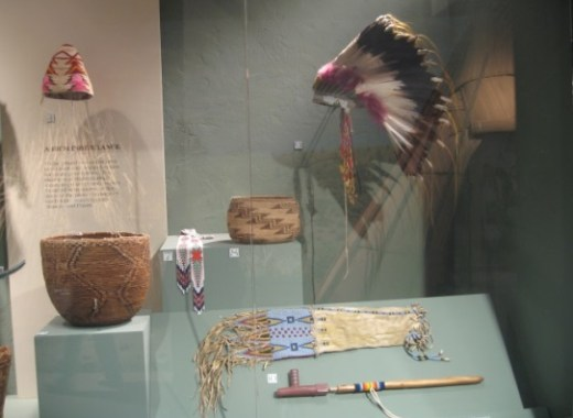 Headdress, pipe, & baskets Warm Springs Museum