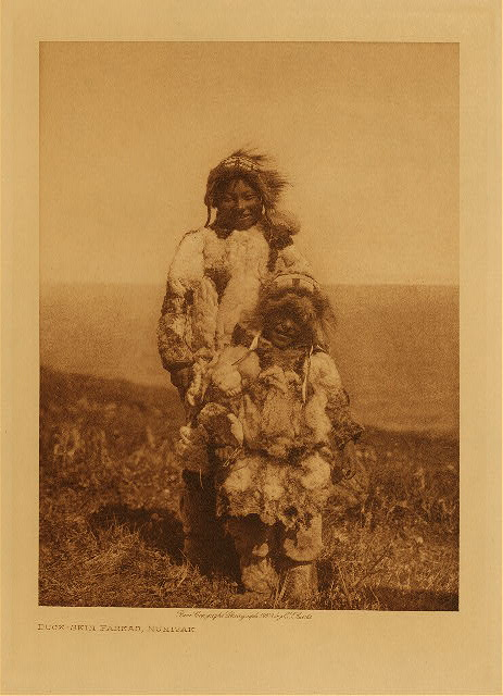 Duck-skin parkas, Nunivak by Edward S. Curtis. 1928.
