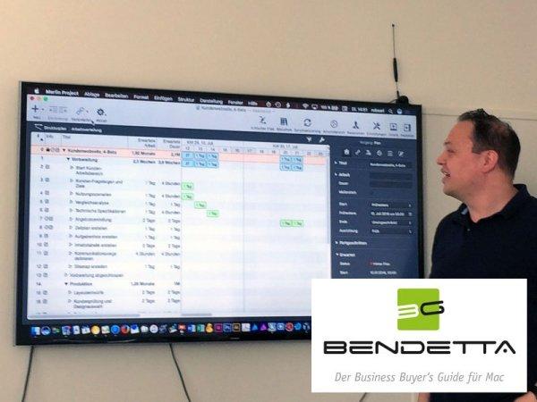 Bendetta.biz Herausgeber Rob Sari zeigt Gründern mit Mac Projektmanagement am Mac mit Merlin Project