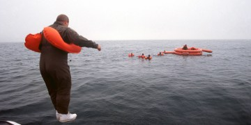 Colonel James Longtine, 128th Air Refueling Wing, General Mitchell International Airport, Milwaukee, takes the plunge into Lake Michigan for a swim to the LRU-15/F-2B 20 Man Life Raft as part of aircrew survival training during Exercise WHITETAIL 2001.
