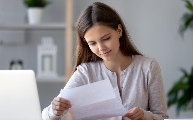 female customer receiving notification statement