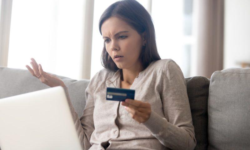 girl checking negative credit items