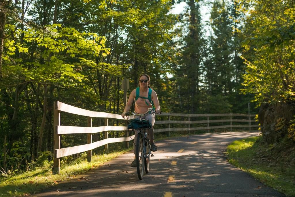 Natalia, biking down a bike path in Mont Tremblant