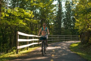 Natalia biking on pathway in Mont Tremblant