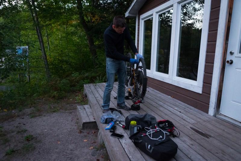 Ben repairing the bike in the ever-darkening forest.