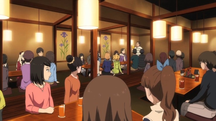 The director in Shirobako celebrates with his team.