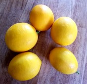 Five lemons on a table