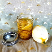 Jar with filled with oil and lemon peel