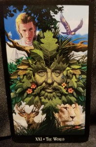 The World A Greenman surrounded by pictures of nature