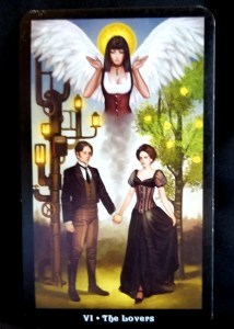 Man and woman holding hands with an angel in the sky above them.