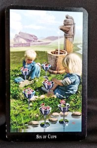 Six of Cups - Tarot Card of the Day Two children sitting next to a pond with six cups filled with flowers