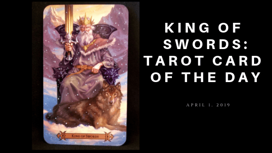 KIng of Swords - a King dressed in winter robes, sitting on a throne, a wolf at his feet.