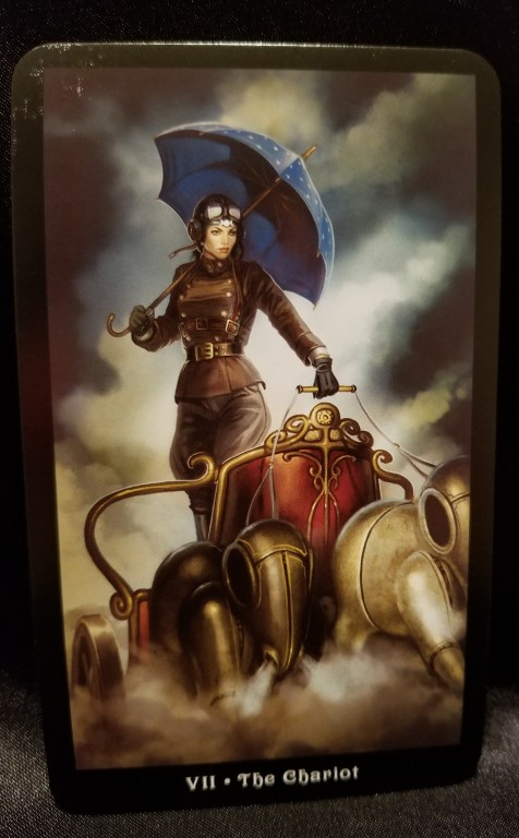 The Chariot - Tarot Card: A woman holding a parasol driving a chariot pulled by mechanical horses
