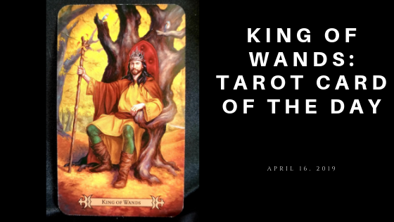 King of Wand - A man sitting on a throne holding a wand