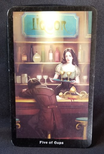 Five of Cups - Tarot Card:  A man sitting at a bar, his head on the bartop, three empty cups at his side.  The barkeep is holding two cups on a tray and looking at him thoughtfully.