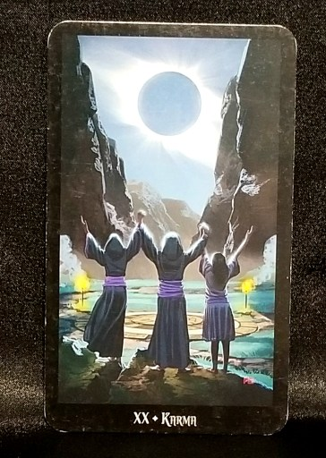 Karma - Tarot Card:  Three individuals at the edge of a ritual circle, arms raised in adoration of the full moon.