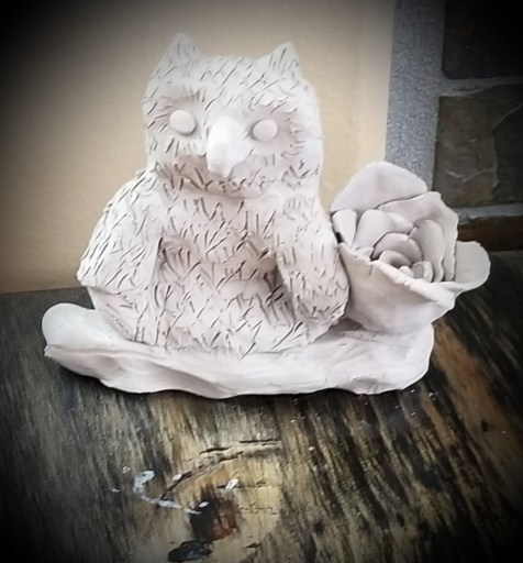 Art as Magick - An owl sitting on a log, a rose at its side